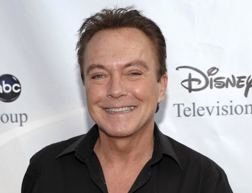 """FILE - In this Aug. 8, 2009, file photo, actor-singer David Cassidy arrives at the ABC Disney Summer press tour party in Pasadena, Calif. A South Florida home that once belonged to the 1970's heartthrob has been sold for $2.6 million. Cassidy rose to fame as a teen idol who starred in """"The Partridge Family."""" He died at age 67 in 2017. (AP Photo/Dan Steinberg, File)"""
