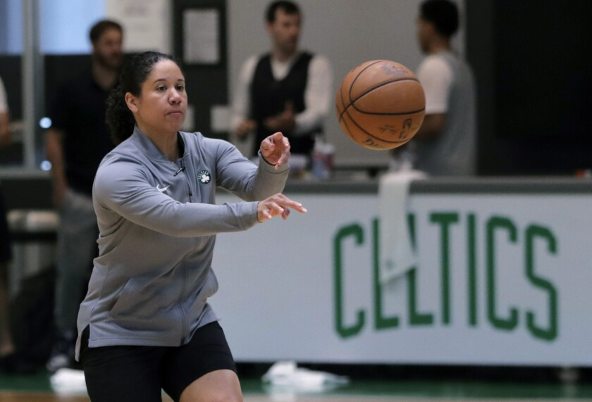 FILE - In this July 1, 2019, file photo, Boston Celtics assistant coach Kara Lawson passes the ball at the team's training facility in Boston. A person familiar with the situation says Duke is in talks with Boston Celtics assistant coach and former WNBA All-Star Lawson to lead the Blue Devils women's basketball program. The person spoke to The Associated Press on condition of anonymity Friday, July 10, 2020, because the school has not commented publicly on its search. (AP Photo/Charles Krupa, File)