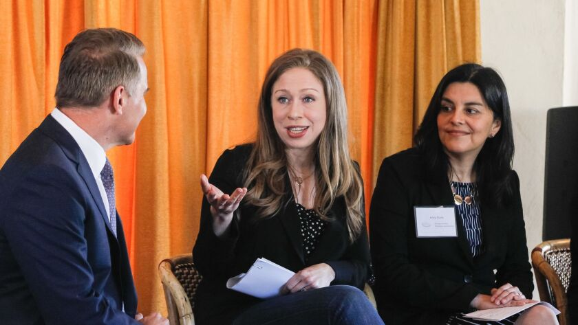 Chelsea Clinton, vice chair of the Clinton Foundation, speaks during a panel discussion of the Strong Families Thriving Communities coalition on Thursday at Balboa Park. Panel members (from left) are Steve Atkinson, 10News, Chelsea Clinton, Amy Aparicio Clark, Aetna Foundation.