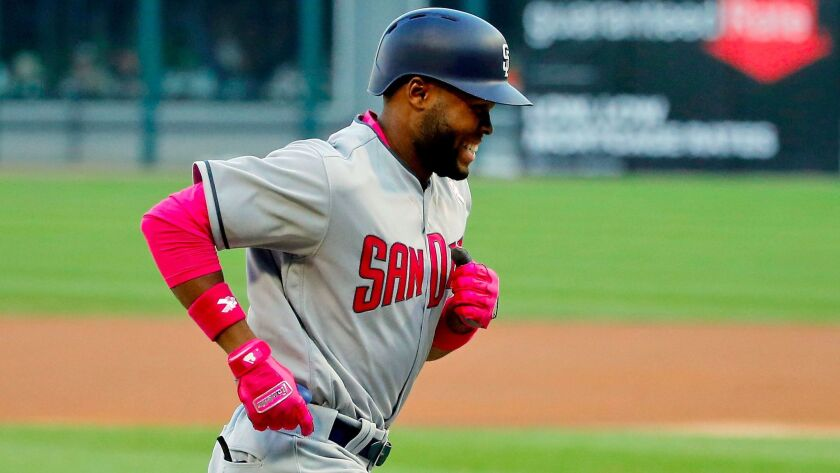 CHICAGO, IL - MAY 13: Manuel Margot #7 of the San Diego Padres smiles as he rounds the bases after h