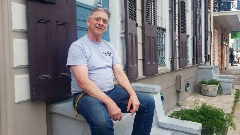 Louis Matassa, owner of Matassa's market, sits on a stoop on Dumaine St