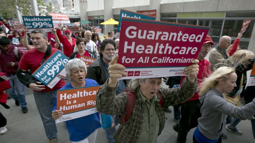 Supporters of single-payer healthcare march in Sacramento in 2017.