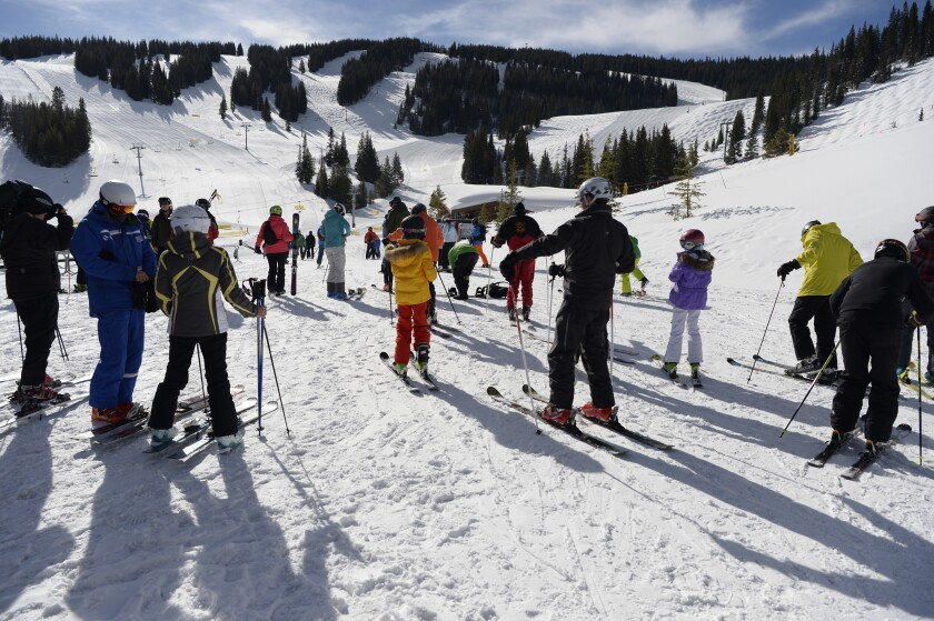 Skiers prepare for their day at the base of Vail in the Mountain Plaza area. Resorts in Colorado are now closed due to the coronavirus.