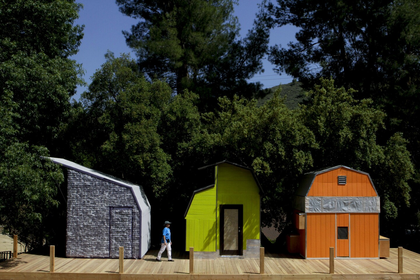 By Lisa Boone Woodbury architecture students transformed 10-by-10-foot sheds into clever and colorful accommodations set up at the Shadow Hills Riding Club equestrian center. The sheds had to be tweaked to provide light, ventilation, insulation and sleeping space for two. And though the teams each had a budget of $1,500 for additional supplies, they also had a mandate to experiment with one assigned material. Pictured here are the cabins from the plastic team, left, the wood team and the paper team.