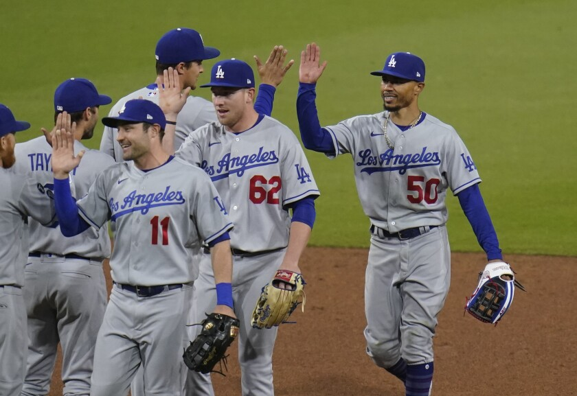 Dodgers celebrate after their victory Saturday.