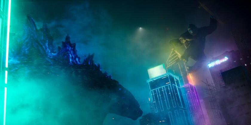 King Kong jumping toward Godzilla