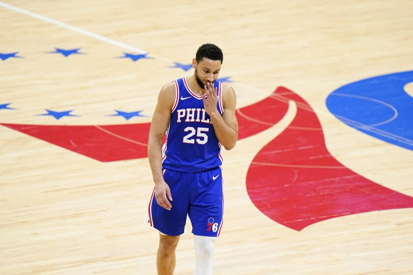 Philadelphia 76ers' Ben Simmons wipes his face during the second half of Game 5 in a second-round NBA basketball playoff series against the Atlanta Hawks, Wednesday, June 16, 2021, in Philadelphia. All-Star guard Ben Simmons could be on the trading block after a miserable postseason. (AP Photo/Matt Slocum)