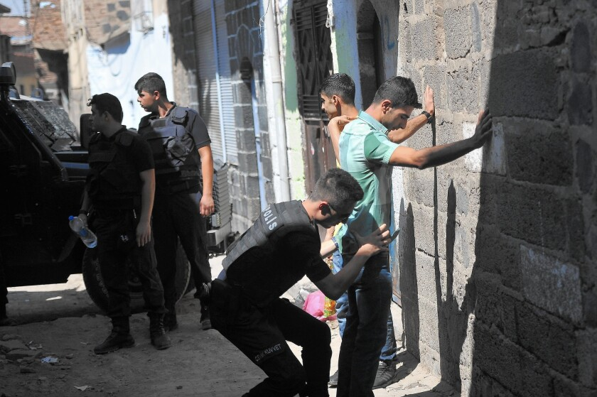 Turkish police search youths during a security operation in Diyarbakir, southeast Turkey.
