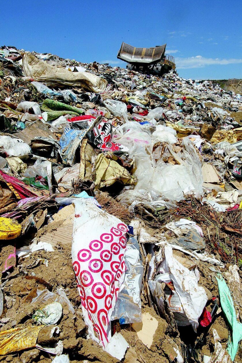 A new assembly bill would reduce plastic trash, such as this mountain of shopping bags at Miramar Landfill. CHARLIE NEUMAN • U-T