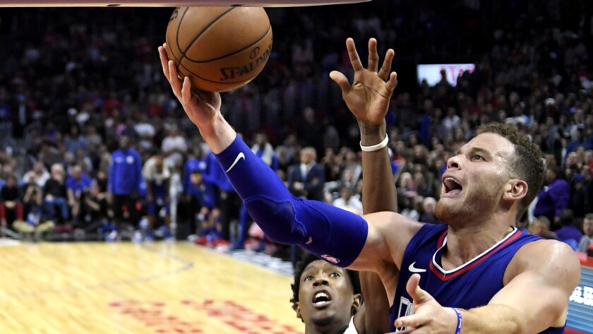 Clippers forward Blake Griffin tries to score along the baseline against Heat forward Josh Richardson during the second half Sunday.