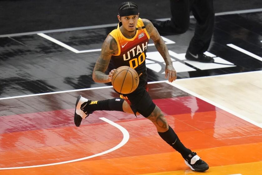 Utah Jazz guard Jordan Clarkson brings the ball up court.