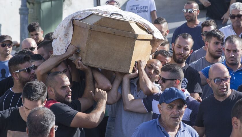 Family members and relatives carry the coffin of Yussef Othman, one of the three security officers killed in a Palestinian shooting, at his funeral in Abu Ghosh, Israel, on Sept. 26, 2017.