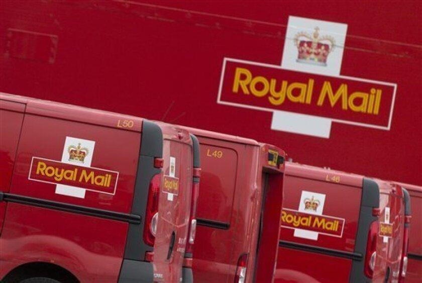 Royal Mail vans lined up at London's largest sorting office Mount Pleasant, Thursday, Sept. 12, 2013. The U.K. coalition government has confirmed plans to privatize the country's 500-year-old Royal Mail this fall. Business Secretary Vince Cable said Thursday an initial public offering of a majority stake in the postal service was scheduled for the coming weeks. (AP Photo/Alastair Grant)