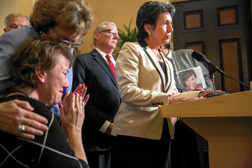 Assemblywoman Susan Talamantes Eggman, right, announces approval of the aid-in-dying legislation in the state Senate in Sacramento in September.