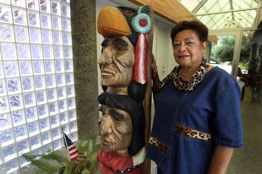 Besides books, Rita Cloud loves art. Her collection includes this totem pole.