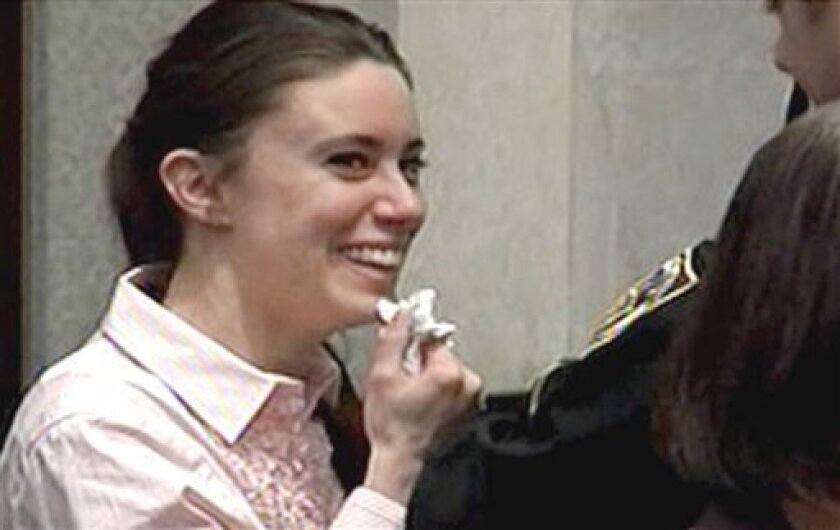 In this image made from video, Casey Anthony smiles as she returns to the defense table after being acquitted of murder charges at the Orange County Courthouse in Orlando, Fla., Tuesday, July 5, 2011. She had been charged with killing her daughter Caylee. (AP Photo/Pool)