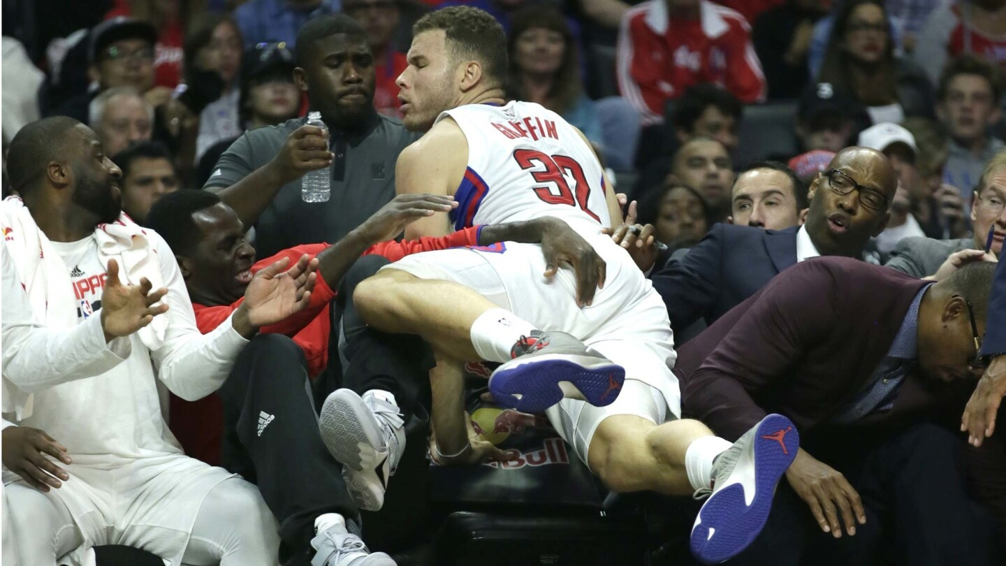 Blake Griffin lands on Clippers teammates as he dives for a loose ball during first half action.