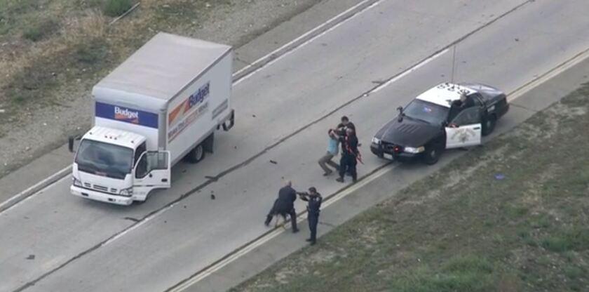 Driver apprehended after pursuit, standoff in stolen rental truck