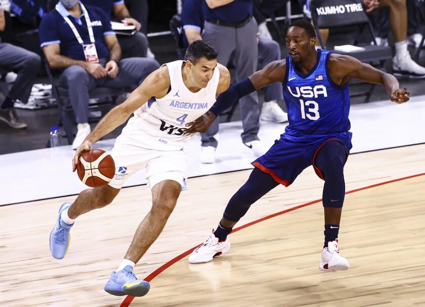 Argentina's Luis Scola (4) drives the ball against United States' Bam Adebayo (13) during the first half of an exhibition basketball game in Las Vegas on Tuesday, July 13, 2021. (Chase Stevens/Las Vegas Review-Journal via AP)