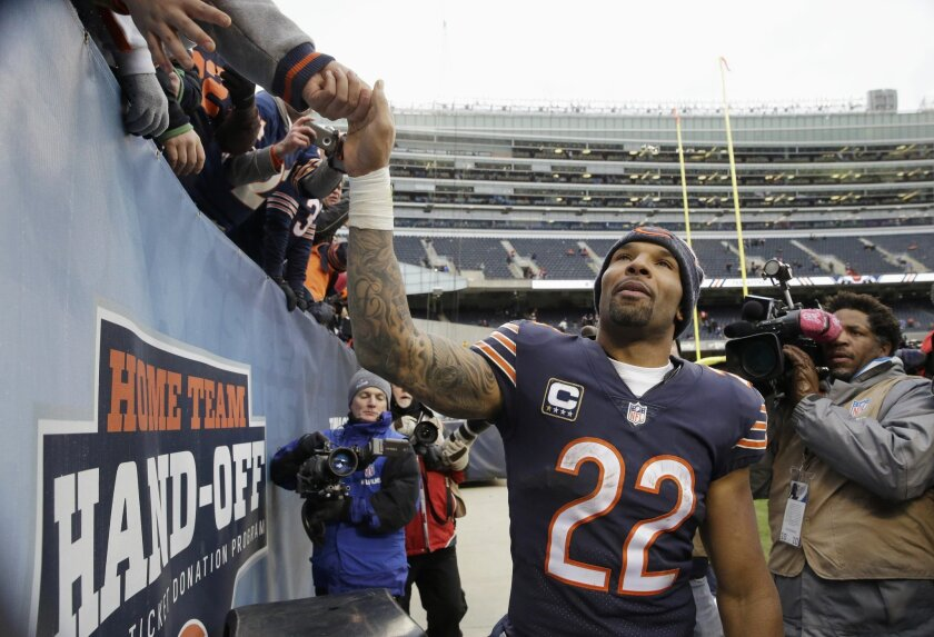 FILE - In this Jan. 3, 2016 file photo, Chicago Bears running back Matt Forte reaches up to fans fans after an NFL football game against the Detroit Lions in Chicago. Forte, a two-time Pro Bowl running back announced on Instagram Friday, Feb. 12, 2016, morning that the team informed him this week i