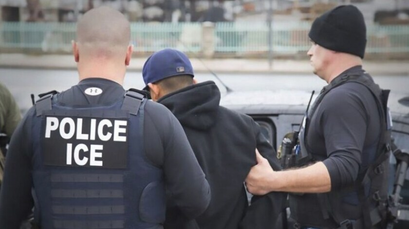 ICE officers arrest a man