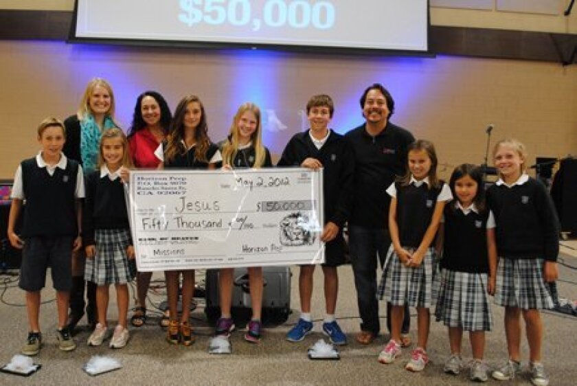 Horizon Prep is celebrating a successful Spirit Run.  The annual event raised $50,000 this year, pushing the total since it's inception to $374,300!  These Horizon Prep Lions are outstanding in the Spirit Run:  (L-R) Colby Mead (Most Laps 1st-4th Grade); Stephanie Malme, Representing Compassion Int