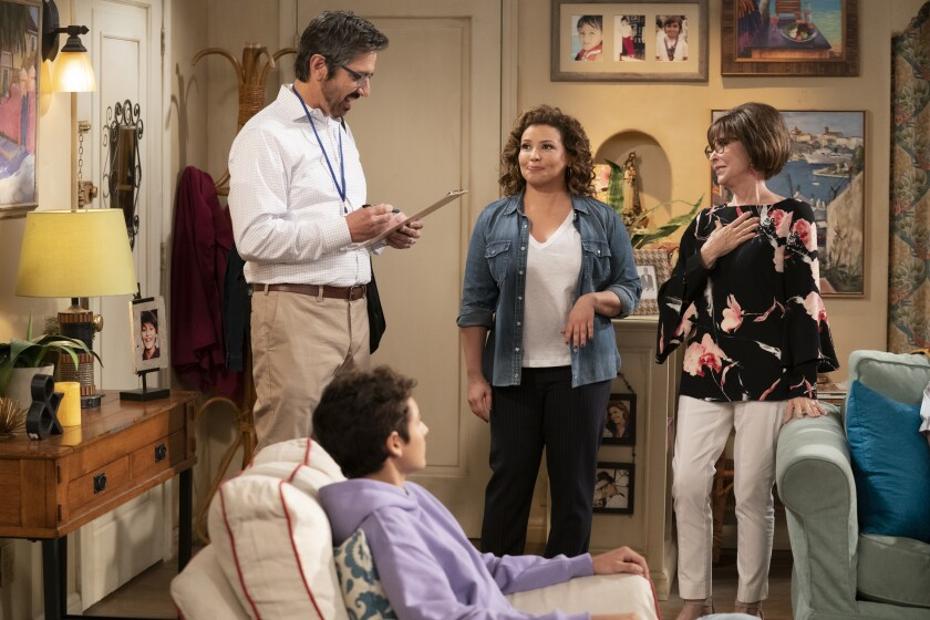 """From left, guest star Ray Romano as a census taker, Marcel Ruiz as Alex, Justina Machado as Penelope and Rita Moreno as Lydia in """"One Day at a Time."""""""