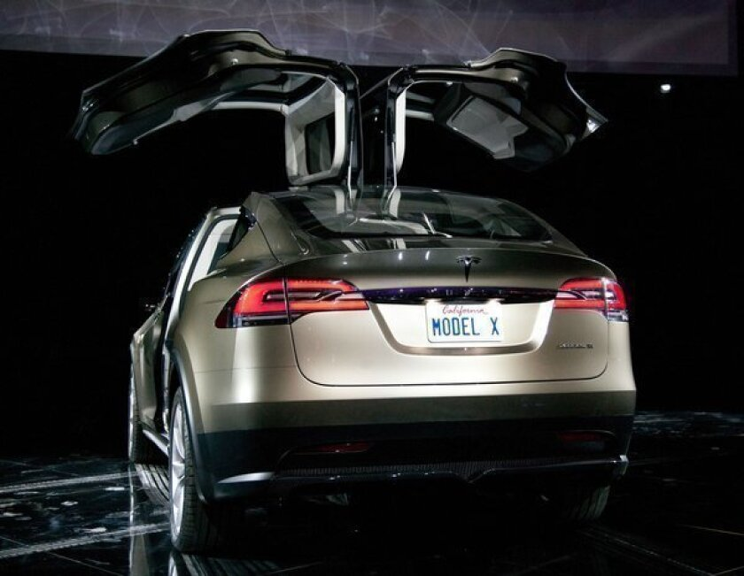 Tesla Motors plans to debut cheaper car in early 2015