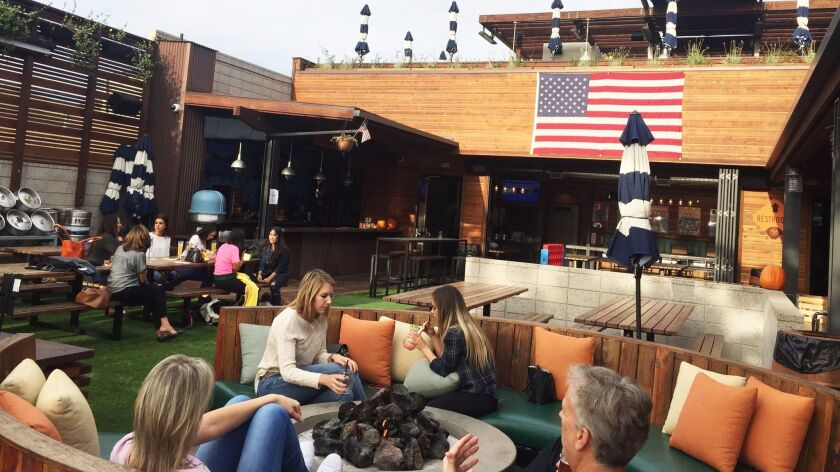 The central courtyard at Park 101, a four-in-one dining and drinking destination that opened July 4, 2017, in Carlsbad Village.