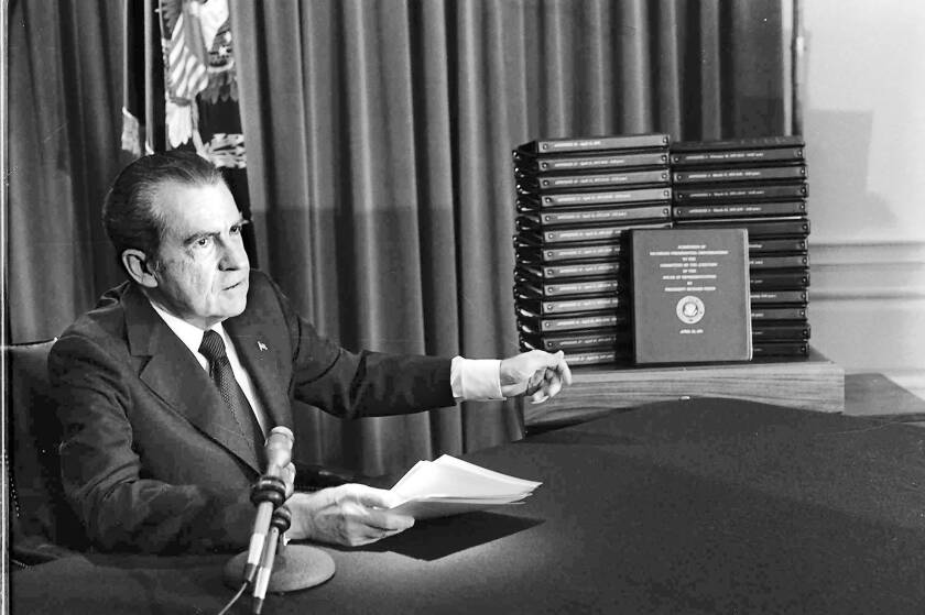 President Nixon with transcripts of the White House tapes.