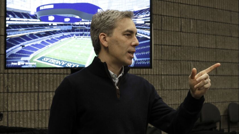 Rams chief operating officer Kevin Demoff answers questions at the media center for Super Bowl LIII in Atlanta.