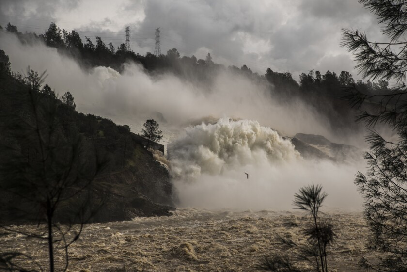 Water cascades down the spillway below Oroville Dam. The water is being released by authorities to avoid flooding at Lake Oroville because of recent heavy rain.