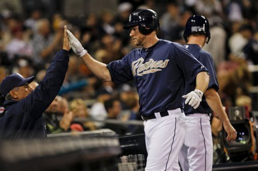 San Diego Padres' Chase Headley high-fives with manager Bud Black after hitting a solo home run in the third inning of an exhibition baseball game against the Kansas City Royals Tuesday, April 3, 2012 in San Diego. (AP Photo/Lenny Ignelzi)
