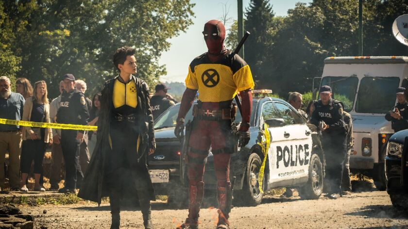"Brianna Hildebrand and Ryan Reynolds in ""Deadpool 2."""