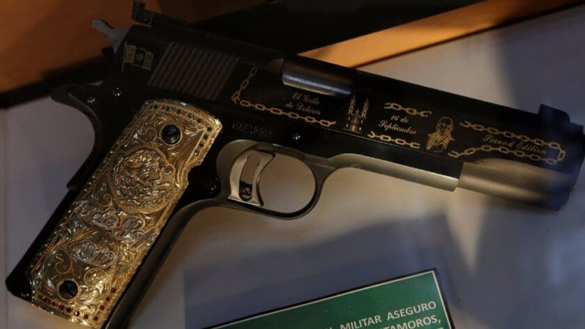 A gun decorated with gold belonging to Mexican drug lord of the Gulf Cartel, Osiel Cardenas Guillen, is displayed in the Drugs Museum at the headquarters of the Ministry of Defense in Mexico City.
