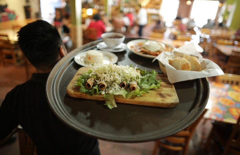 A tray of food leaves the kitchen at Guelaguetza in Koreatown.