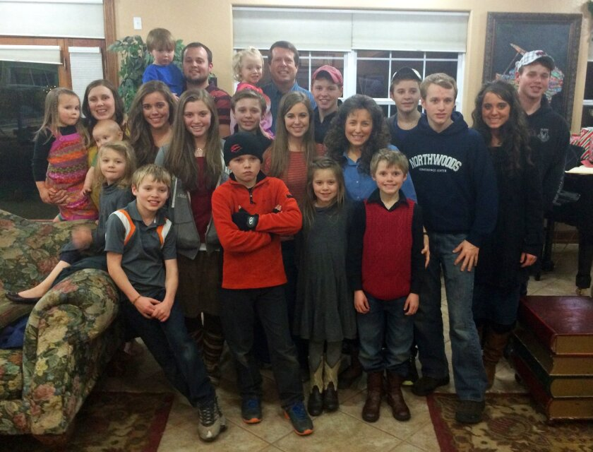 "When a child inappropriately touches a sibling, the situation ""impacts and involves the entire family,"" Imagawa said. Above, an undated photo of the Duggar family, who star in the reality TV series ""19 Kids & Counting."""