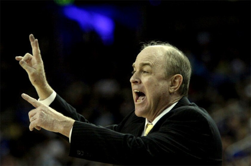 UCLA Coach Ben Howland instructs his team in a game against Arizona.