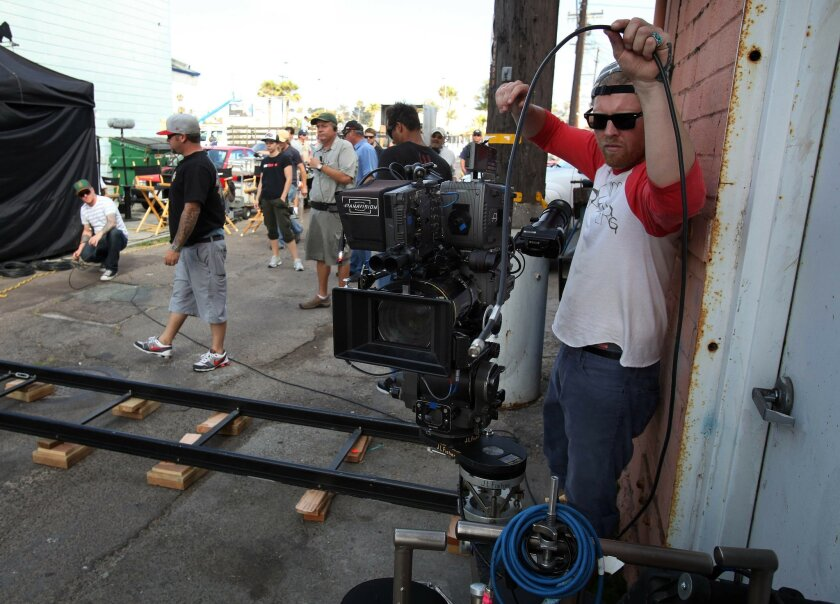 "Second assistant Michael Sharp readies a camera during the filming of the new show ""Terriers"" in Ocean Beach, which was picked after a search of California coastal cities."