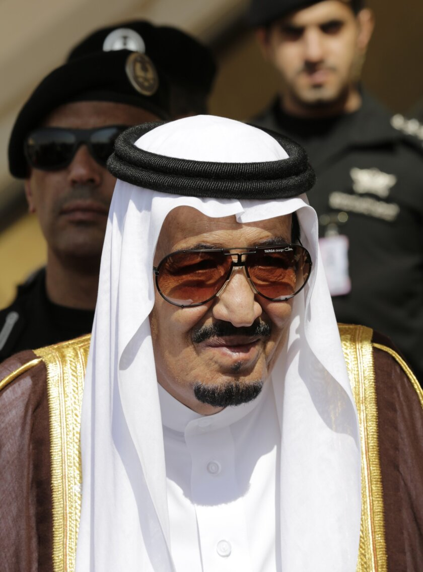FILE -- In this Nov. 10, 2015 file photo, King Salman of Saudi Arabia waits to receive leaders during their arrival to participate in a summit of Arab and South American leaders in Riyadh, Saudi Arabia. Within hours of ascending to the Saudi throne, King Salman announced sweeping changes that would recast the kingdom's line of succession, and rework its security and economic decision-making processes. It marked the start of what would be a tumultuous year for King Salman, who completes one year as monarch on Saturday, Jan. 23, 2016. (AP Photo/Hasan Jamali, File)