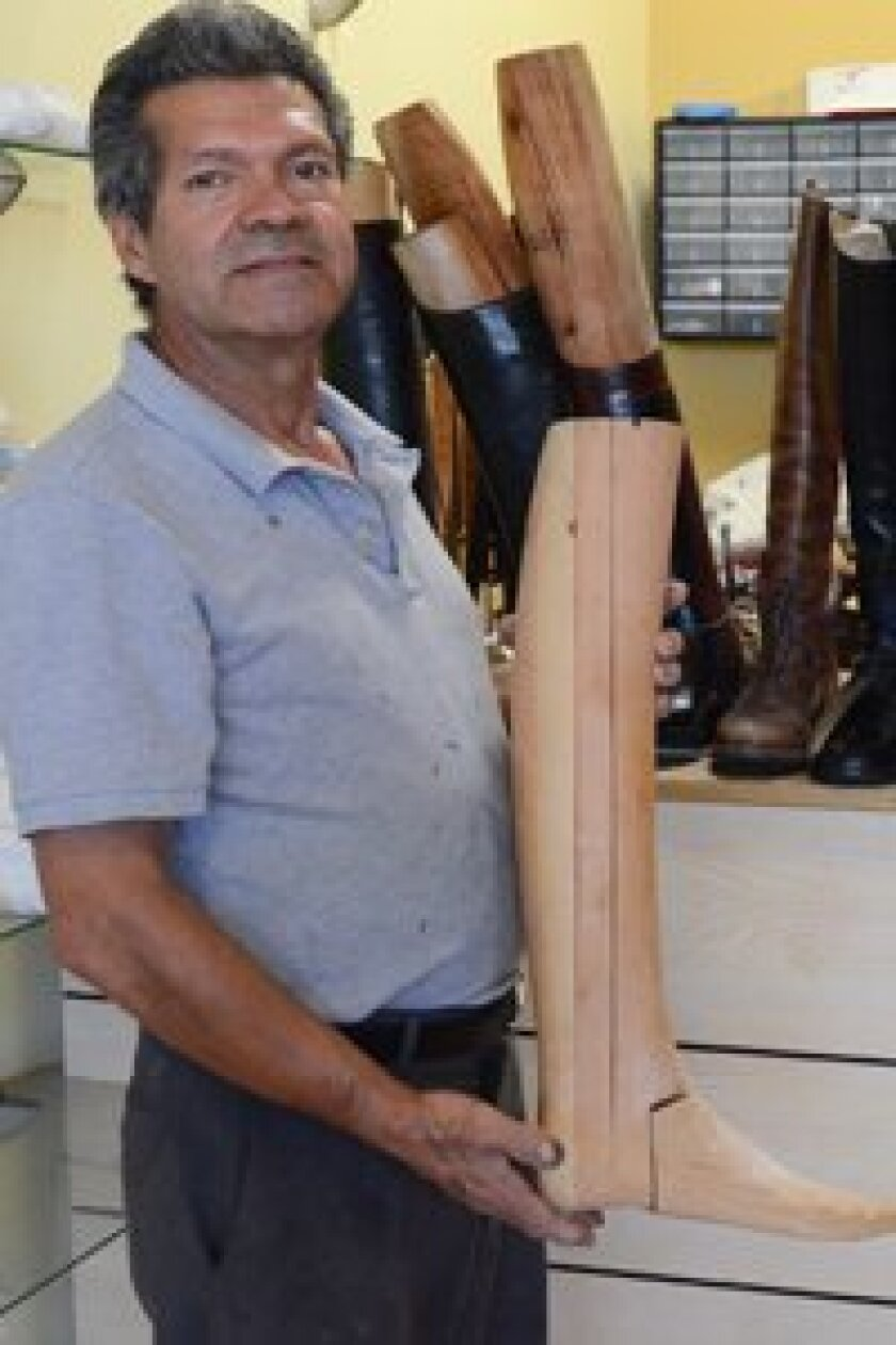 """Wilfredo """"Fred"""" Moreno of Fred's Shoes+ custom designs boot trees based on his clients' needs, and also replaces zippers and adjusts boot tubes. In addition, he provides repair on all leather equestrian equipment. Photo/Kelley Carlson"""