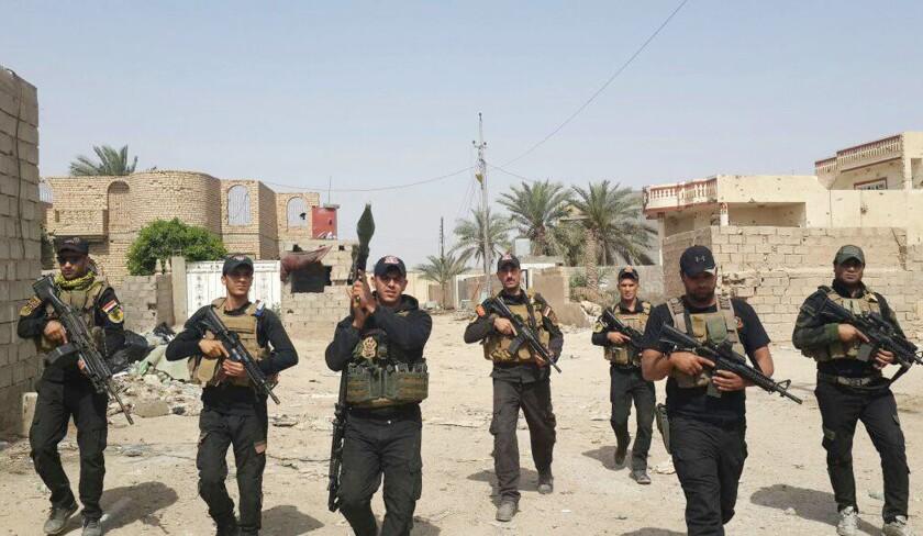 Iraqi anti-terrorism forces patrol in central Ramadi, Iraq, on April 18, 2015.