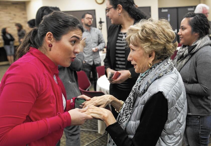 Holocaust survivor Edith Eva Eger speaks to Maria Elena Parada following Eger's presentation to the Jewish Law Society of Whittier Law School in Costa Mesa.