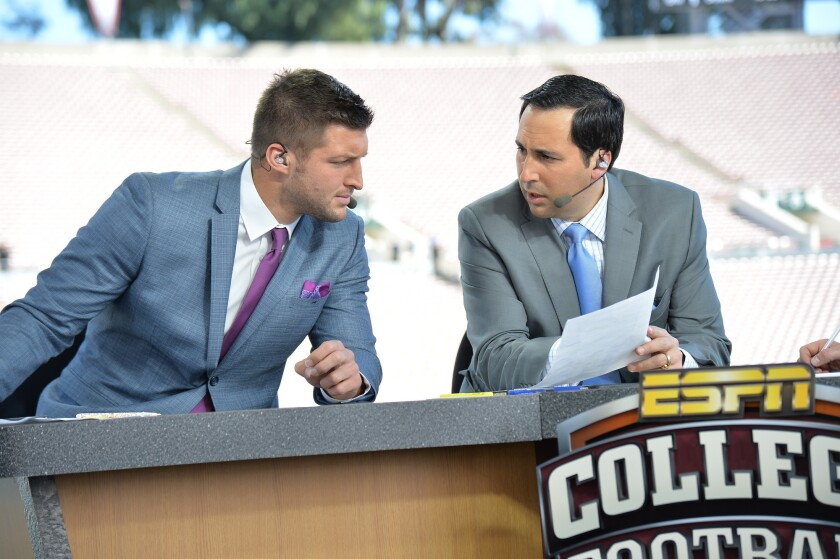 Tim Tebow and Joe Tessitore on the set of College Football Live.