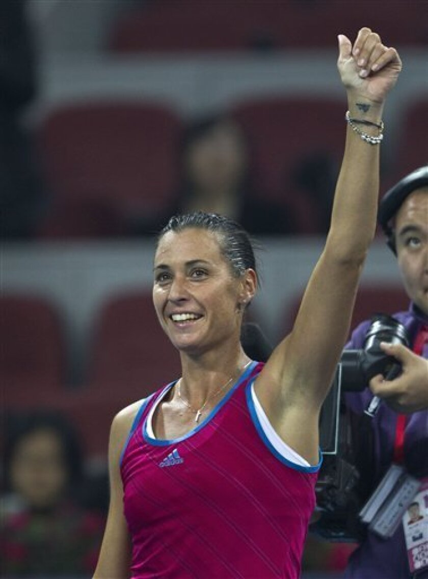 Flavia Pennetta of Italy gestures after she defeated top-ranked Caroline Wozniacki of Denmark in their singles quarterfinal match of the China Open tennis tournament in Beijing Friday, Oct. 7, 2011. Pennetta defeated Wozniacki, 3-6, 6-0, 7-6. (AP Photo/Andy Wong)