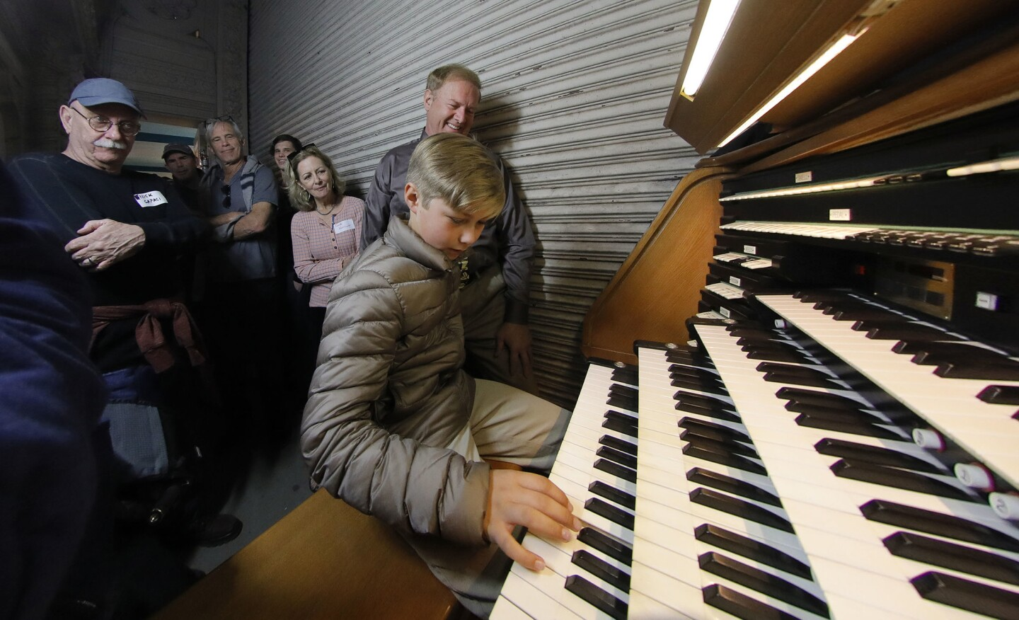 While relatives watch, 9-year-old Claus Russell of Napa, the great-great-great-grandson of John D. Spreckels, the youngest Spreckels descendant to attend the Spreckels family reunion, plays a few notes at the Spreckels Organ Pavilion in Balboa Park.