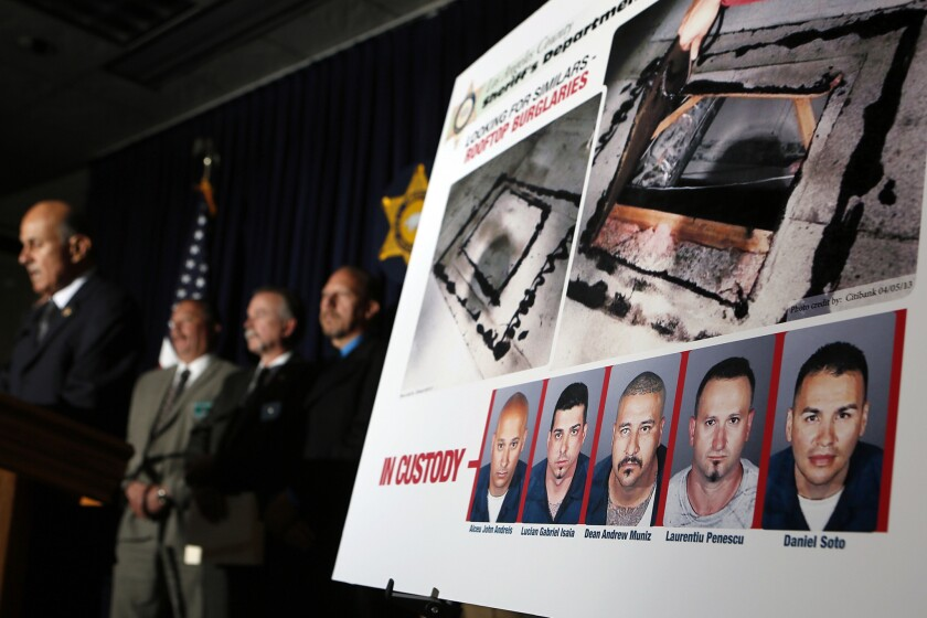 Former L.A. County Sheriff Lee Baca, left, announces in April 2013 the capture of the alleged members of a bank burglary ring that cut through the roofs of bank branches to access their vaults.