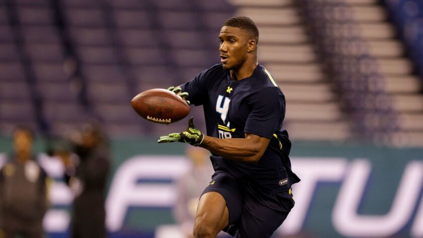 UCLA defensive back Fabian Moreau runs a drill at the NFL football scouting combine.