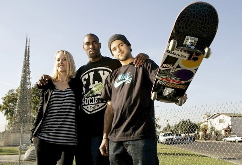 Circe Wallace of Wasserman Media Group, left, and pro skaters Terry Kennedy and Paul Rodriguez on vacant land near the towers.