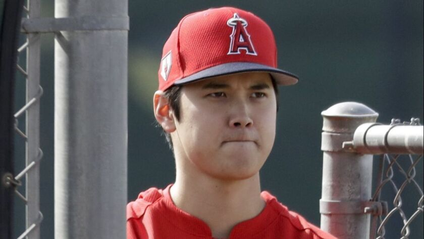 Los Angeles Angels Shohei Ohtani, of Japan, watches pitching practice at their spring baseball train